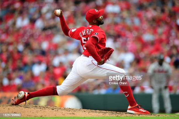 Amir Garrett of the Cincinnati Reds pitches during a game between the Atlanta Braves and Cincinnati Reds at Great American Ball Park on June 26, 2021...