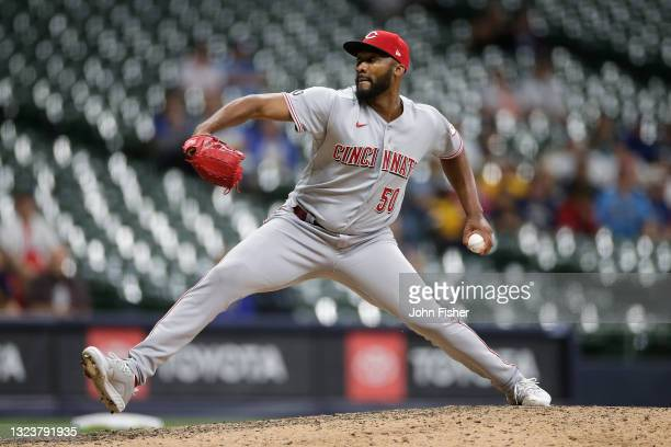 Amir Garrett of the Cincinnati Reds pitches for the final out in the tenth inning against the Milwaukee Brewers at American Family Field on June 15,...