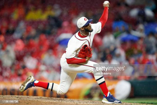 Amir Garrett of the Cincinnati Reds pitches in the eighth inning against the Texas Rangers at Great American Ball Park on June 15, 2019 in...