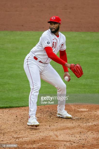 Amir Garrett of the Cincinnati Reds pitches in the eighth inning against the Cleveland Indians at Great American Ball Park on April 17, 2021 in...