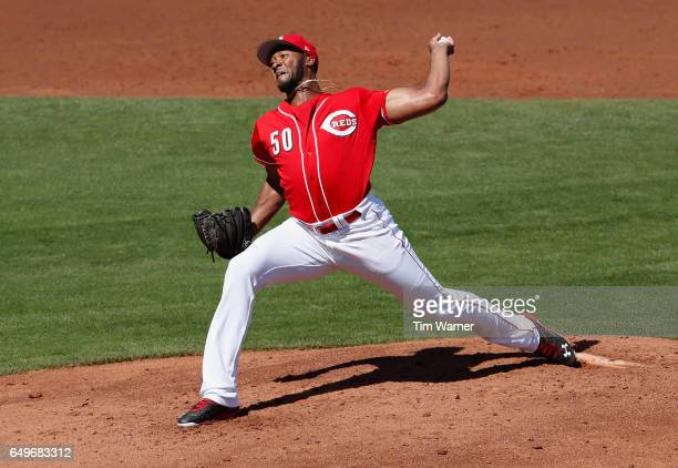 Amir Garrett of the Cincinnati Reds pitches in the first inning against the Los Angeles Angels during the spring training game at Goodyear Ballpark...