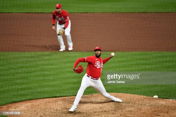 Amir Garrett of the Cincinnati Reds pitches in the ninth inning against the Arizona Diamondbacks at Great American Ball Park on April 21, 2021 in...