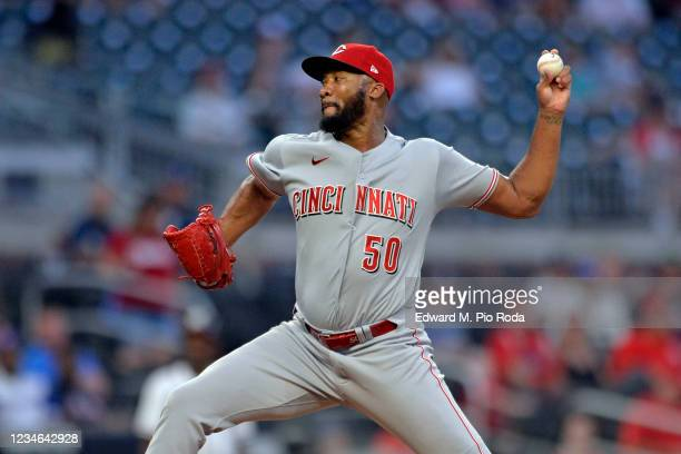 Amir Garrett of the Cincinnati Reds pitches in the ninth inning against the Atlanta Braves at Truist Park on August 12, 2021 in Atlanta, Georgia.