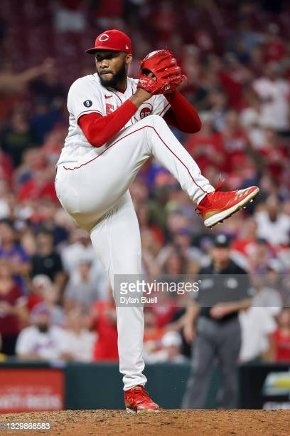 Amir Garrett of the Cincinnati Reds pitches in the ninth inning against the New York Mets at Great American Ball Park on July 20, 2021 in Cincinnati,...