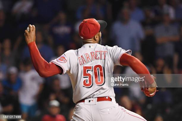 Amir Garrett of the Cincinnati Reds pitches in the ninth inning against the Chicago Cubs at Wrigley Field on July 27, 2021 in Chicago, Illinois.