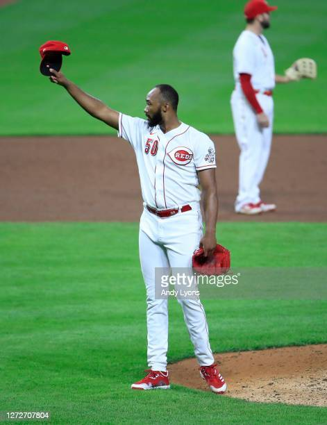 Amir Garrett of the Cincinnati Reds tips his hat in the direction of the Pirates following the final out of the 4-1 win against the Pittsburgh...