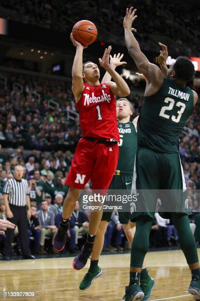 Amir Harris of the Nebraska Cornhuskers tries to get a shot off over Xavier Tillman of the Michigan State Spartans during the second half at Breslin...