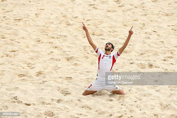 Amir Hosein Akbari Fartkhouni of Iran celebrates scoring a goal during the Men's Beach Soccer gold medal match between Iran and Japan during the 2014...