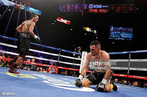 Amir Imam heads to a neutral corner after knocking down Fidel Maldonado Jr in the fifth round of their super lightweight fight at the MGM Grand...