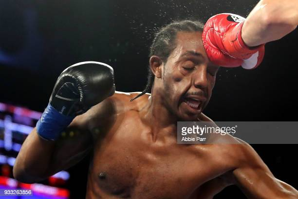 Amir Imam is punched by Jose Ramirez during their WBC junior welterweight fight at The Theatre at Madison Square Garden on March 17 2018 in New York...