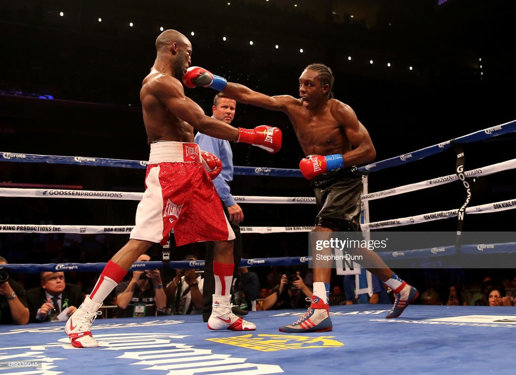 Amir Imam (L) throws a punch at Yordens Ugas in their super lightweight match at Galen Center on May 10, 2014 in Los Angeles, California. Stiverne won in a six round technical knockout.