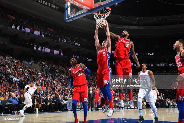 Amir Johnson and Dario Saric of the Philadelphia 76ers grabs the rebound against the Miami Heat at Wells Fargo Center on February 14 2018 in...