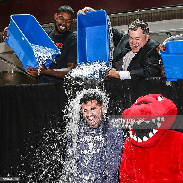 Amir Johnson, and Tim Leiweke, get Nazem Kadri in the ALS Ice Bucket Challenge outside the Air Canada Centre August 20, 2014.