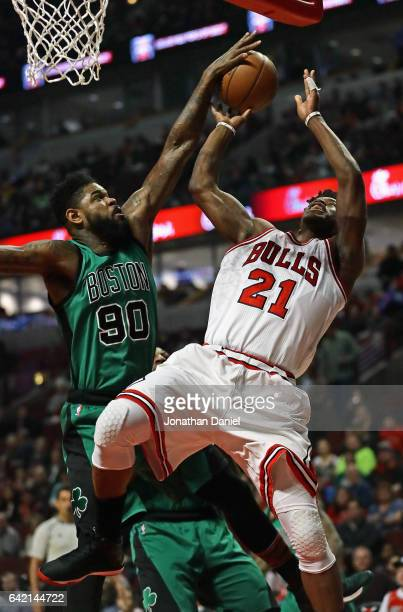 Amir Johnson of the Boston Celtics blocks a shot attempt by Jimmy Butler of the Chicago Bulls at the United Center on February 16 2017 in Chicago...
