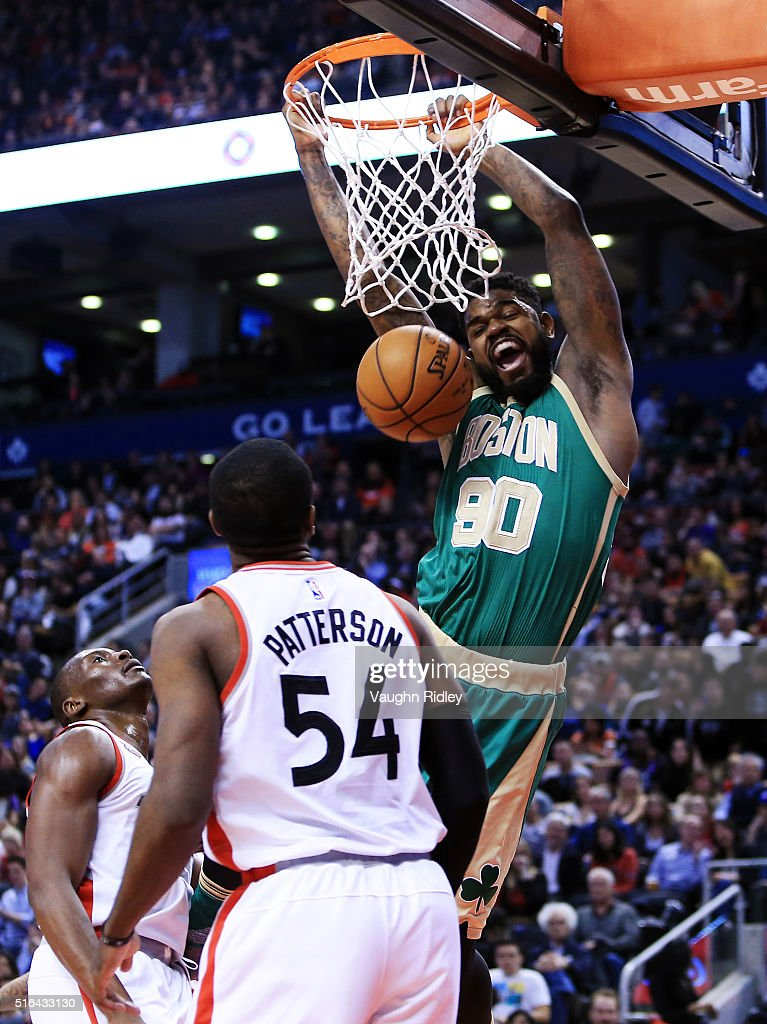 Amir Johnson #90 of the Boston Celtics dunks the ball during the second half of an NBA game against the Toronto Raptors at the Air Canada Centre on March 18, 2016 in Toronto, Ontario, Canada.