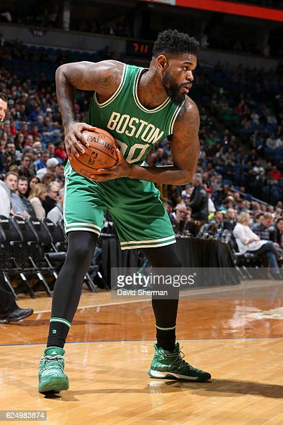 Amir Johnson of the Boston Celtics handles the ball against the Minnesota Timberwolves on November 21 2016 at Target Center in Minneapolis Minnesota...