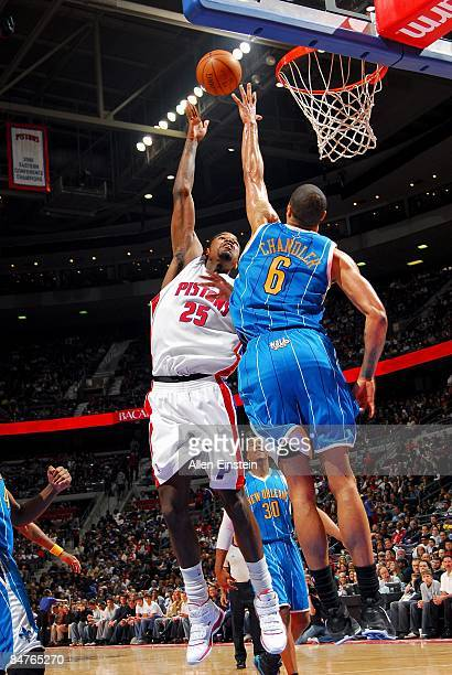 Amir Johnson of the Detroit Pistons puts up a shot over Tyson Chandler of the New Orleans Hornets during the game on January 17 2009 at The Palace of...
