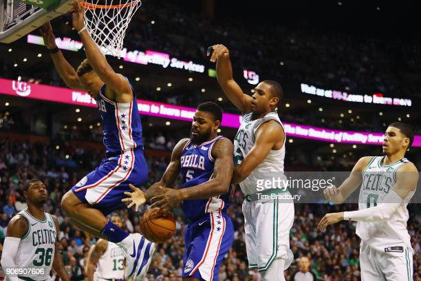 Amir Johnson of the Philadelphia 76ers battles for the ball with Al Horford of the Boston Celtics during the second half of their game at TD Garden...