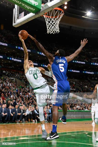 Amir Johnson of the Philadelphia 76ers blocks the shot by Jayson Tatum of the Boston Celtics on January 18 2018 at the TD Garden in Boston...