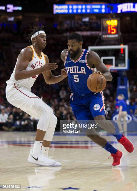 Amir Johnson of the Philadelphia 76ers drives to the basket against Myles Turner of the Indiana Pacers in the first quarter at the Wells Fargo Center...