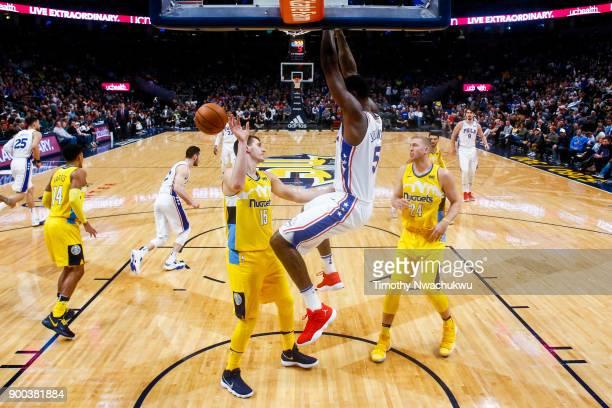 Amir Johnson of the Philadelphia 76ers dunks over Nikola Jokic of the Denver Nuggets at the Pepsi Center on December 30 2017 in Denver Colorado NOTE...