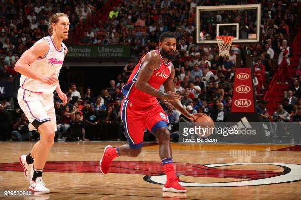 Amir Johnson of the Philadelphia 76ers handles the ball against Kelly Olynyk of the Miami Heat on March 8 2018 at American Airlines Arena in Miami...