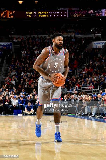 Amir Johnson of the Philadelphia 76ers handles the ball against the Cleveland Cavaliers on November 23 2018 at the Wells Fargo Center in Philadelphia...
