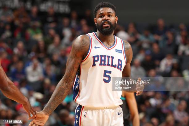 Amir Johnson of the Philadelphia 76ers looks on during the game against the Charlotte Hornets on March 19 2019 at Spectrum Center in Charlotte North...