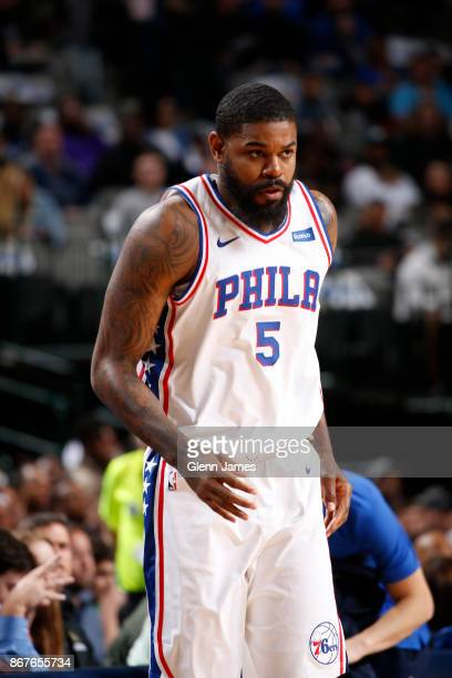 Amir Johnson of the Philadelphia 76ers looks on during the game against the Dallas Mavericks on October 28 2017 at the American Airlines Center in...