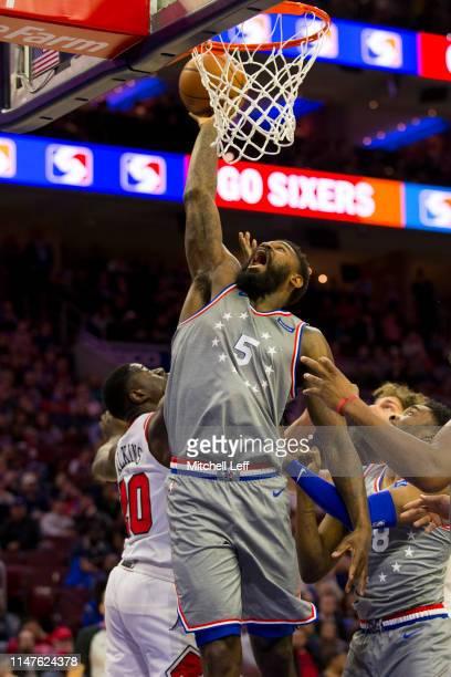 Amir Johnson of the Philadelphia 76ers reaches for the ball against the Chicago Bulls at the Wells Fargo Center on April 10 2019 in Philadelphia...