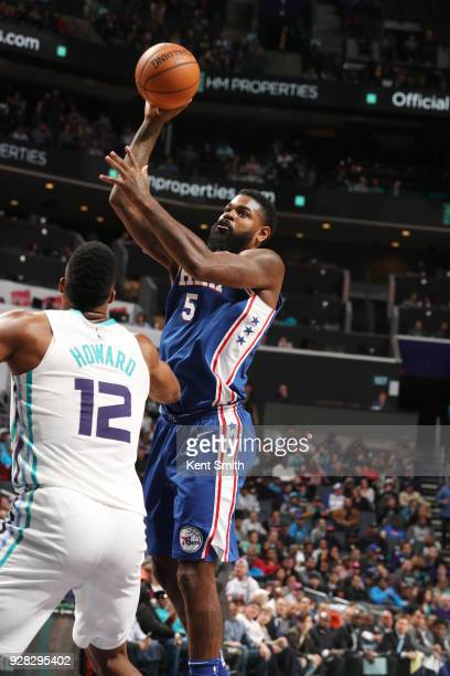 Amir Johnson of the Philadelphia 76ers shoots the ball during the game against the Charlotte Hornets on March 6 2018 at Spectrum Center in Charlotte...