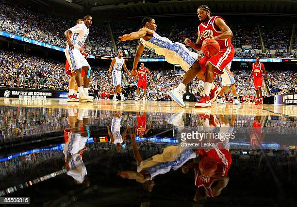 Amir Johnson of the Radford Highlanders drives into Larry Drew II of the North Carolina Tar Heels during the first round of the NCAA Division I Men's...