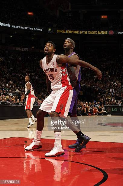 Amir Johnson of the Toronto Raptors battles for positioning against Jermaine O'Neal of the Phoenix Suns on November 30 2012 at the Air Canada Centre...