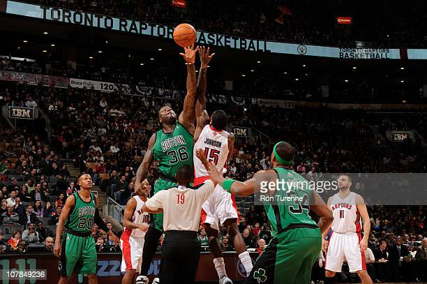 Amir Johnson of the Toronto Raptors battles for the opening tipoff against Shaquille O'Neal of the Boston Celtics during a game on January 2 2011 at...