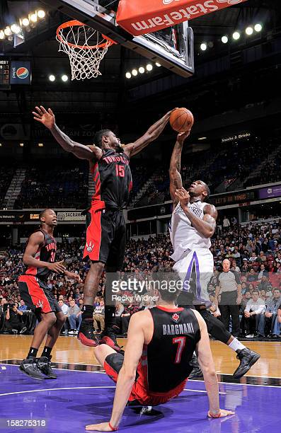 Amir Johnson of the Toronto Raptors blocks the shot of Thomas Robinson of the Sacramento Kings on December 5 2012 at Sleep Train Arena in Sacramento...
