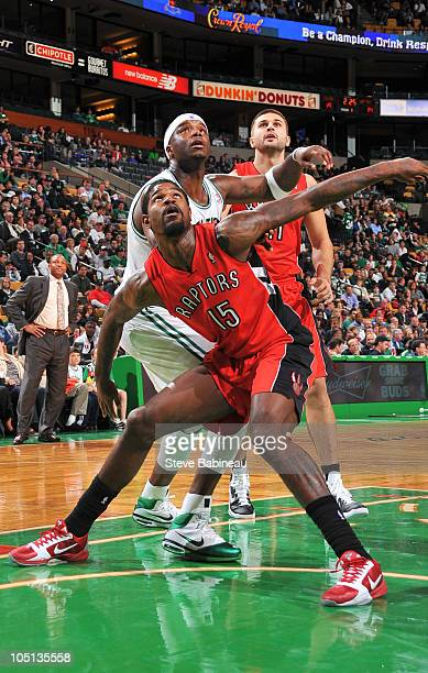 Amir Johnson of the Toronto Raptors boxes out against Jermaine O'Neal of the Boston Celtics on October 10 2010 at the TD Garden in Boston...