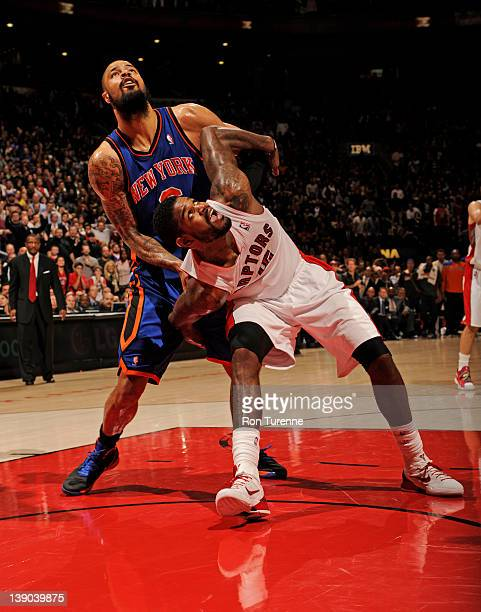 Amir Johnson of the Toronto Raptors boxes out Tyson Chandler of the New York Knicks during the game on February 14 2012 at the Air Canada Centre in...