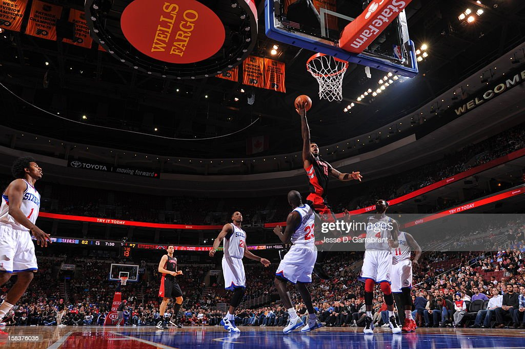 Amir Johnson #15 of the Toronto Raptors drives to the basket against the Philadelphia 76ers at the Wells Fargo Center on November 20, 2012 in Philadelphia, Pennsylvania.