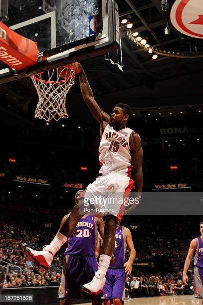 Amir Johnson of the Toronto Raptors dunks against Jermaine O'Neal of the Phoenix Suns during the game on November 30 2012 at the Air Canada Centre in...