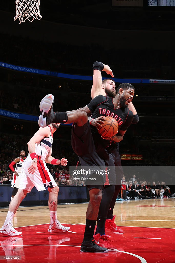 Amir Johnson #15 of the Toronto Raptors grabs a rebound against the Washington Wizards on January 31, 2015 at Verizon Center in Washington, DC.