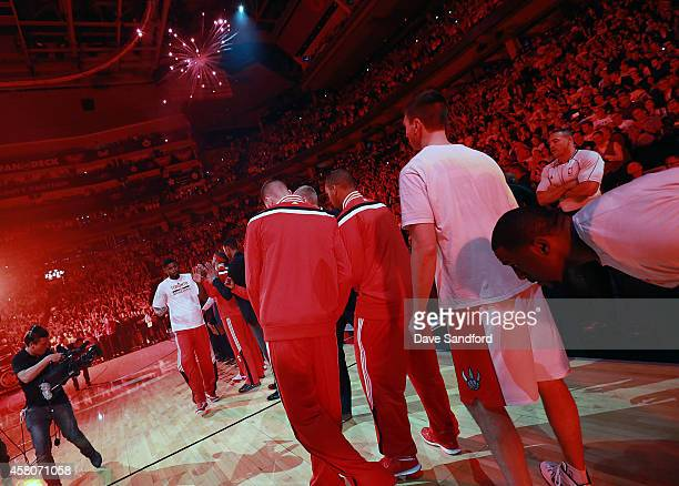 Amir Johnson of the Toronto Raptors is introduced to the crowd prior to facing the Atlanta Hawks during their NBA game at the Air Canada Centre on...
