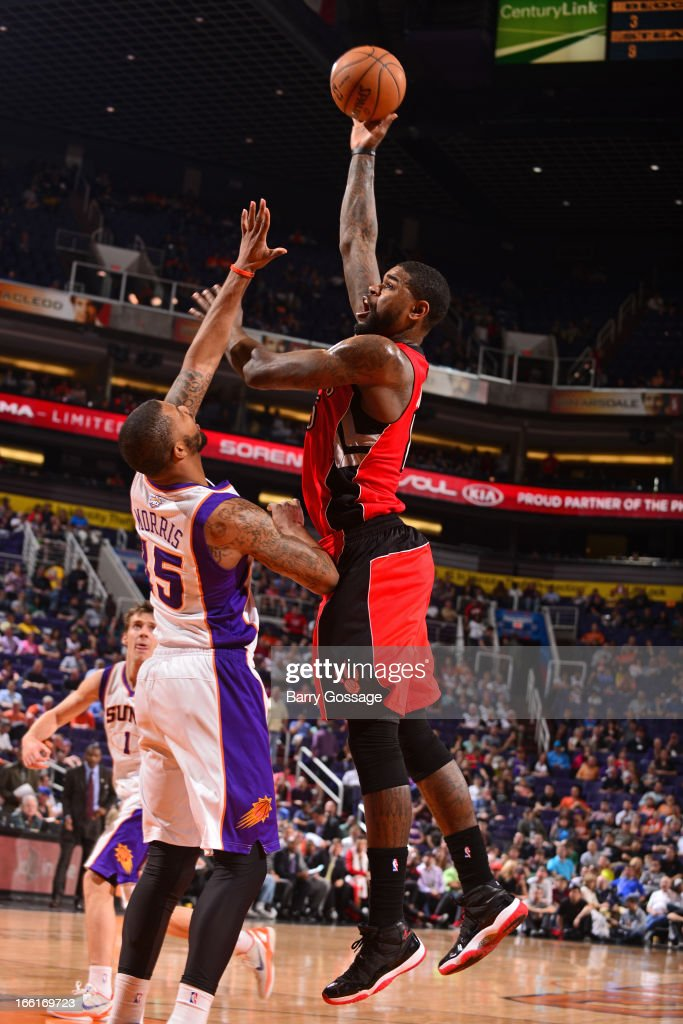 Amir Johnson #15 of the Toronto Raptors puts up a shot against the Phoenix Suns on March 6, 2013 at U.S. Airways Center in Phoenix, Arizona.