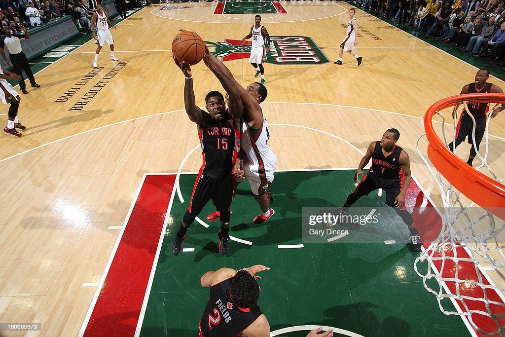 Amir Johnson #15 of the Toronto Raptors shoots against John Henson #31 of the Milwaukee Bucks on November 2, 2013 at the BMO Harris Bradley Center in Milwaukee, Wisconsin.