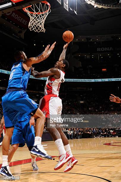 Amir Johnson of the Toronto Raptors shoots against Tyson Chandler of the Dallas Mavericks during the game on February 27 2011 at the Air Canada...