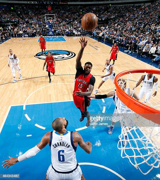 Amir Johnson of the Toronto Raptors shoots against Tyson Chandler of the Dallas Mavericks on February 24 2015 at the American Airlines Center in...