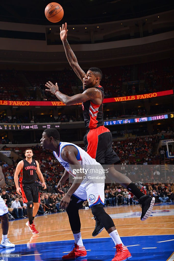 Amir Johnson #15 of the Toronto Raptors shoots the ball against Jrue Holiday #11 of the Philadelphia 76ers during the game at the Wells Fargo Center on November 20, 2012 in Philadelphia, Pennsylvania.