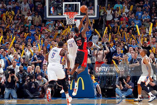 Amir Johnson of the Toronto Raptors shoots the game winning shot against the Oklahoma City Thunder during the game on March 20, 2011 at the Oklahoma...
