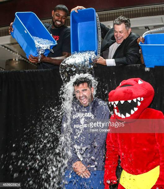 Amir Johnson, Tim Leiweke, and Jermain Defoe, get Nazem Kadri in the Ice Bucket Challenge outside the Air Canada Centre August 20, 2014.