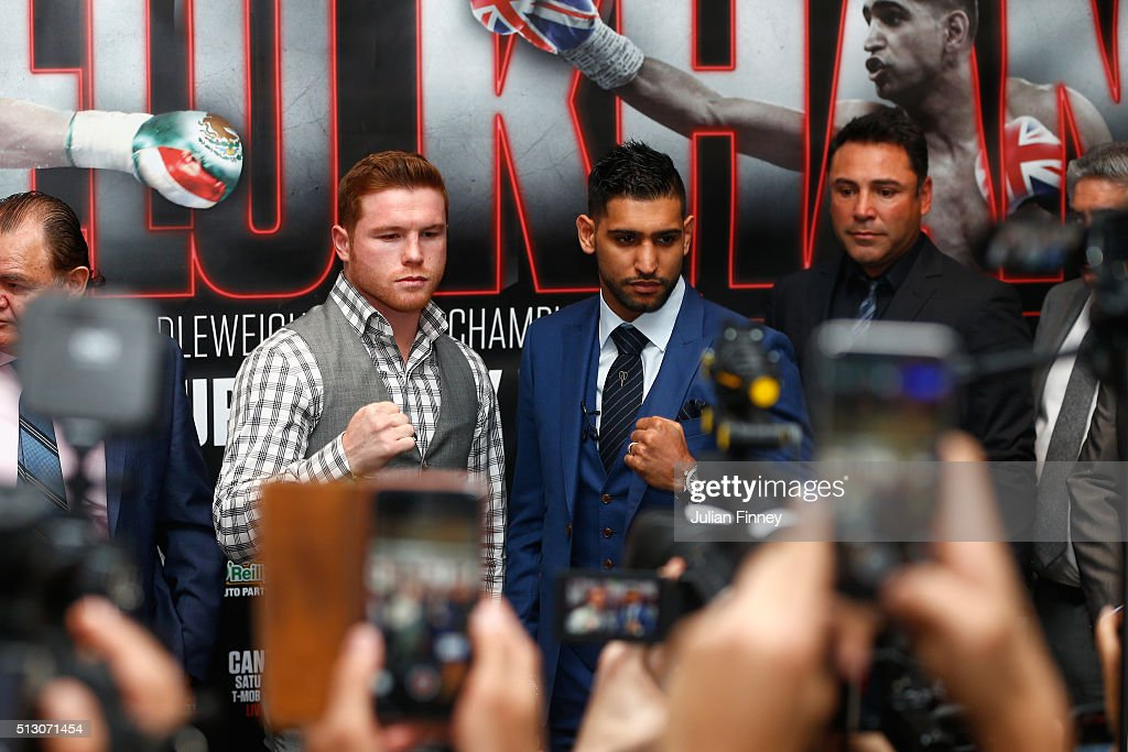 Amir Khan and Canelo Alvarez pose together during a press conference to preview the fight between Amir Khan and Canelo Alvarez at the Park Plaza Riverbank Hotel on February 29, 2016 in London, England.