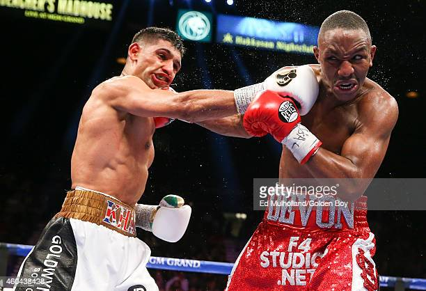 Amir Khan and Devon Alexander trade punches during their welterweight bout at the MGM Grand Garden Arena on December 13 2014 in Las Vegas Nevada Khan...